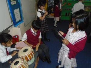 J1 pupils record a soundtrack on their school iPads