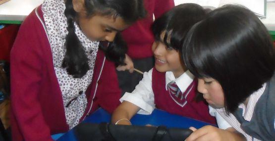 J1 children using their school iPads
