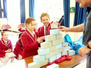 J3R building a pyramid
