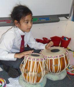 J1 pupil at Highclare St Paul's plays the Tabla